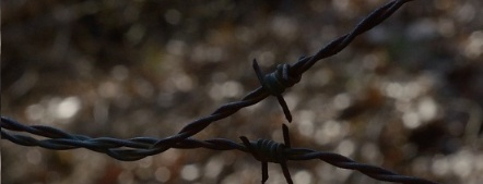 Barbed wire around abandoned coal mine