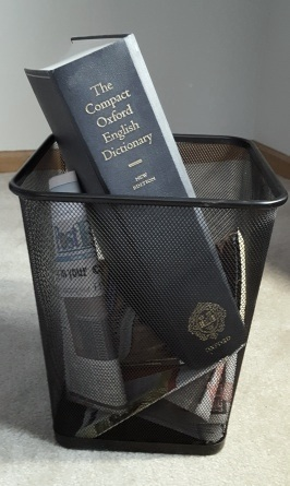 Dictionary in trash basket