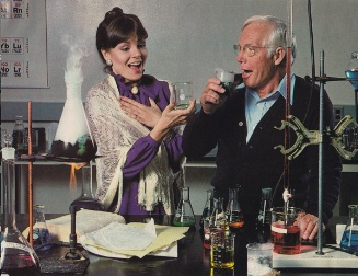 Scientists drinking from beakers