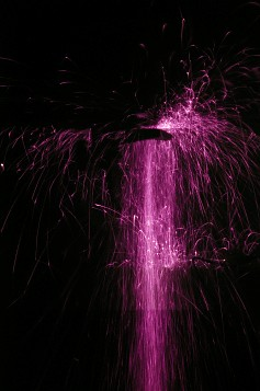 Ultraviolet photo of sparks from grinding steel