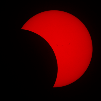 Eclipse in H-alpha showing sunspots