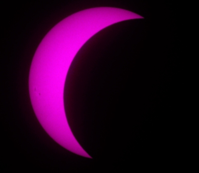 Eclipse in near-ultraviolet showing faint sunspots