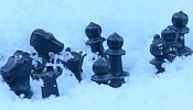 Chess pieces in the snow